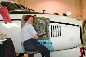 Katja Kusterko-VanCleave works on an aircraft completion in Stevens Aviation's 10,000-square-foot primary hangar, which is also used for interior modifications.