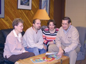 """L to R: Judy, David, Jennie and Donald Born meet in the conference room at Born Aviation Products to discuss their series of children's books. Created by the Born family, the """"Adventures of Stick and Rudder"""" were released last spring."""