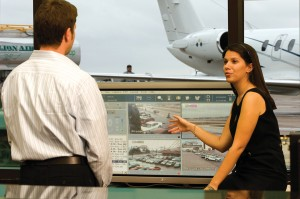 Million Air employees monitor the security system on the FBO's plasma screen.