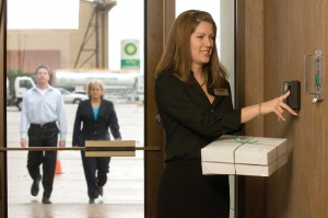 This customer service representative uses biometric access control to take catering to awaiting aircraft.