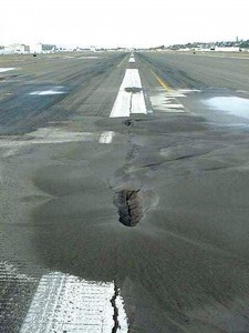 This photo taken on Feb. 28, 2001, shows pavement liquefaction damage of Runway 13R/31L.
