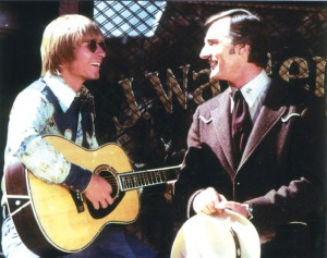 "Singer John Denver (left) was good friends with Dennis Weaver, and once offered him the song ""Back Home Again"" to help Weaver's singing career."