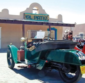A rare 1930s Morgan three-wheeler sports car racer contrasts with mission-style New Mexico architecture.