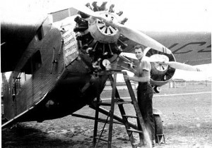 John Anderson polishes a Ford Tri-Motor at Virginia Beach in September 1939.