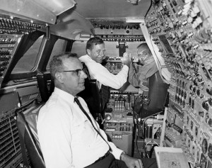 Pan Am Captain Paul Roitsch and Sud Aviation test pilot Juan Franchi show flight engineer John Anderson the Concorde flight simulator in Toulouse, France.