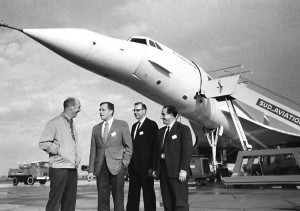 John Anderson (second from left) discusses Concorde flight evaluation with (L to R) Andre Turcat, Sud Aviation chief test pilot; Paul Roitsch, chief pilot, technical, Pan Am; and Brian Trubshaw, chief test pilot, British Airways.