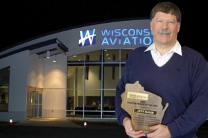 Several state and national aviation organizations have come to recognize Jeff Baum as an influential businessperson. Baum displays the plaque he received when the Wisconsin Airport Management Association named him the 2003 Aviation Person of the Year.