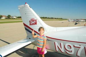 Rachel, the daughter of one of Norm Grant's friends, is just one of the children whose first airplane ride was in the Ultimate Arrow.