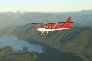 A Glasair Sportsman 2+2 flies over the Cascade Mountains near the firms' production plant in Arlington, Wash.