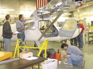Glasair President Mikael Via (left) oversees work at the Arlington plant on a customer-built Sportsman 2+2. Owners build at least 51 percent of the plane to meet FAA regulations for kit plane construction.