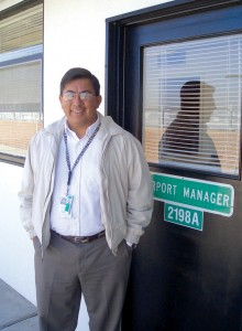 "Willy Vasquez, GM of Palomar-McClellan Airport, passes through the doors of time. His modular office soon will be torn down and rebuilt for Palomar's ""total airport makeover."""