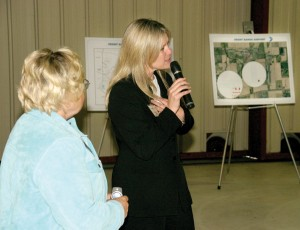 Bobbi Thompson (left), executive VP of Airport Business Solutions, and Angela West of Stallion 51 Corporation, present the Gathering's site selection criteria.