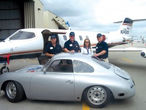 Jeff Hathorn (far right) shows off his classic Porsche to L to R, Best AeroNet's Steve Woolstenhulme, Roger Humiston and Chandra Stewart at the 2005 Florida Aviation & Business Jet Preview.