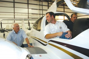 DA-42 position holder Blake Picquet (center), Ft. Worth, talks with Craig Smith, Diamond regional sales manager (left) as Mike Pace inspects the panel.