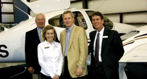 Craig Smith, Diamond sales manager (left) and Michael Hedding, director of sales, flank Premier Aircraft Sales co-owners Amy Newman and husband Lacy. Co-owner Fred Ahles isn't pictured.
