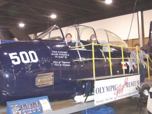 This T-28 fuselage, used by the Olympic Flight Museum in parades and at air shows, was popular with youth visiting the conference.