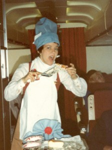 Rita Husmann works the first-class aisle, and has fun in a chef costume made from airline pillowcases and linen napkins.