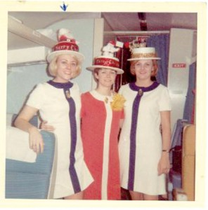 In 1968, her first year of flying, Rita Husmann (center) and fellow flight attendants wear Christmas hats they designed themselves to celebrate flying on Christmas Eve.
