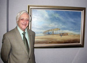 Douglas Ettridge with his painting depicting the Wright brothers' first flight.