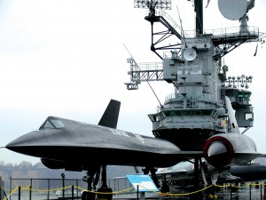 An SR-71 on loan is poised quietly beneath the Island Bridge. This A-12 Blackbird spy plane will probably never fly again.