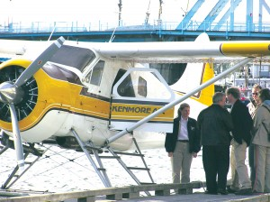 Passengers gather at Kenmore Air's dock for their day's flight in a de Havilland Beaver.