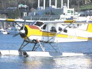 One of Kenmore Air's floatplanes taxis to its dock on Lake Union in downtown Seattle.