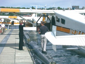 Kenmore Air's crews check out one of the airline's floatplanes in preparation for the day's flights.