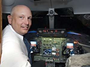 Leading Landmark's ambitious strategy of integration and acquisition is CEO Roger Wolfe, seen here in a Lear 36 outfitted with EFIS flight displays and synthetic vision avionics.
