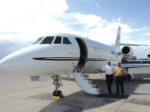 L to R: Gary D. Pavel, chief pilot for MediaNews Group, and Capt. Gary Horst get ready to board the Falcon 2000. A months-long analysis preceded CEO Dean Singleton's decision to trade in MediaNews' previous craft for the 2000.