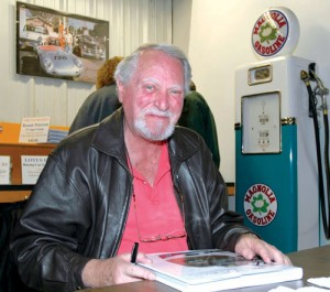 Clive Cussler autographs a recent book.