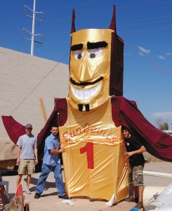 "L to R: ""Dipsomaniacal Devils"" Steve Brennick, Mitch Nielsen and Christoph Weber spent the last two days before the Flugtag putting the finishing touches on their entry, a 30-foot tall replica of the Arizona State University school mascot, Sparky."