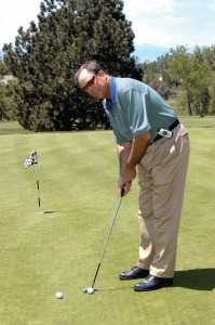 Dave Bolick, head golf professional and instructor, demonstrates proper form when playing golf.