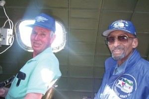 Photographer Lee Auger (left) and former Tuskegee B-25 pilot O. Oliver Goodall took two of the seats in the radio compartment.