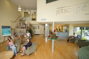 The super-cool lobby at Jetscape Services is modeled after a 1960s retro style with stainless steel fixtures and antique Pam Am aircraft posters.