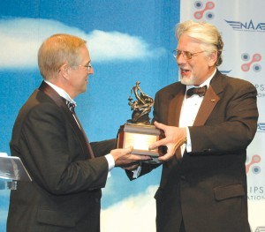 David Ivey, president of the National Aeronautic Association, presented the 2005 Collier Trophy to Eclipse Aviation CEO Vern Raburn.