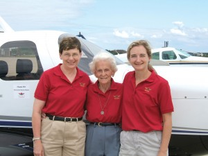 L to R: Gretchen Jahn, 86-year-old Ruby Sheldon and Julie Filucci in front of Jahn's new 2005 Mooney Ovation2, before racing in the 2005 Air Race Classic.