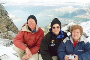 Gretchen Jahn, (center) husband Karl Sutterfield and Mardell Haskins, team 21 during the international Around New Zealand 2004 Air Race, enjoy views atop the clouds from The Remarkables above Queenstown, South Island in New Zealand.