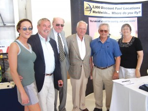 L to R: Linsey Lips, Jerry Lips, Bob Hoover, Barron Hilton, Hannes Linke and Laurie Lips visit in front of JFI's booth.