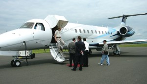 A visitor exits the Legacy 600 while others wait their turn to inspect it.