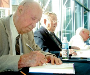 L to R: Bunny Comstock, Frank Klibbe and Freddy Fredrickson participate in a busy autograph session at The Museum of Flight.