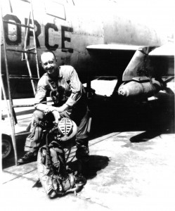 "Lieutenant Colonel Harold E. ""Bunny"" Comstock in front of an F-100 in Vietnam in 1965."