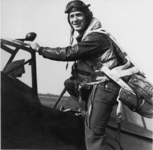 Second Lieutenant Walter R. Groce climbs into the cockpit of his P-47 in July 1944, at Boxted Air Base in England.