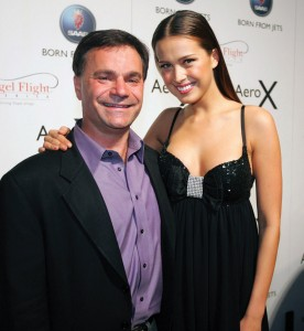 It's not all hard work: Jay Spenchian meets with model Petra Nemcova at the New York International Auto Show.