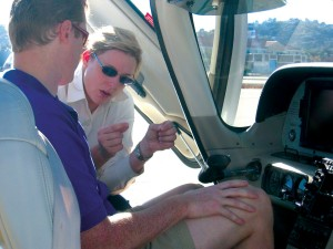 April D. Gafford, CEO and chief flight instructor at JATO Aviation, conducts cockpit familiarization in a Cirrus with one of the firm's 30 current clients.
