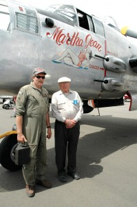 Martha Jean owner and pilot David Wheaton (left) visits with Doolittle Raider Bill Bower in front of the B-25.