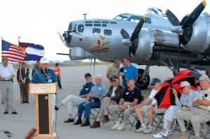 Despite the rain, World War II veterans attended Aluminum Overcast's arrival on June 8. Speaking at the podium is Robert Doubek from the board of commissioners at Centennial Airport. The Citizen Heroes History Squadron from Gateway High School is holding