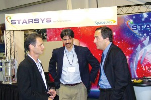 Mark Sirangelo (far right) discusses the Dream Chaser spacecraft with team members from Oceaneering International, Inc.