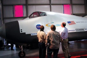 Engineers from SpaceDev check out the Dream Chaser spacecraft during a VIP event at Centennial Airport.