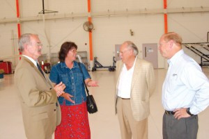 L to R: Kerry McPherson, Cindy Christianson of Western Gas Resources, Inc., Clark Onstad of Precision Jet Management, and Rich Bjelkevig talk aviation during Mountain Aviation's open house.
