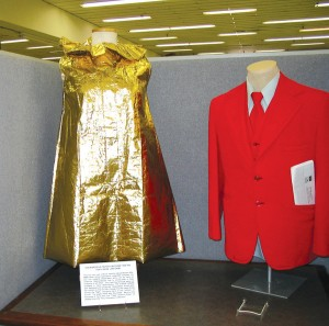 Because World War II made material hard to come by, some airline stewardesses would wear regular uniforms, such as the red outfit on the right, to the airport, and then change into a paper dress. Following a shift, the attendant would change back again.